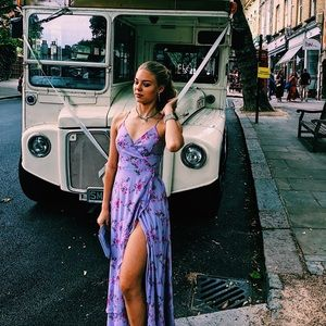 A maxi lavender dress with hints of pink flowers.